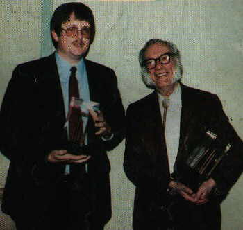 Here we see a younger, geekier, and slightly more overweight Orson Scott Card, standing next to Sir Isaac Asimov, both of whom are holding their Nebula awards--Mr. Card clearly does not need me to tell him how awesome he is