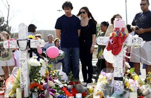Christian Bale visiting memorial at Aurora