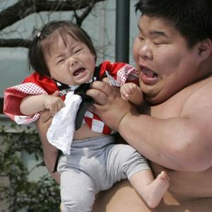 fat man with crying baby