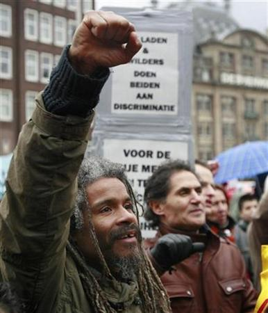 This demonstrator in Amsterdam, protesting Wilders and his film, is arguing in the civilized manner--without a gun--and I applaud him for it