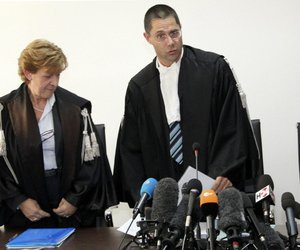Marco Billi (right) reads the verdict