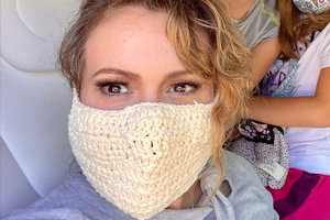 Alyssa Milano wearing a crocheted mask