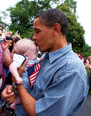 Obama kissing a baby and the American flag