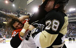 Pittsburgh Penguin fighting a Philadelphia Flyer