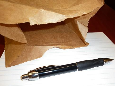 A paper bag and a pen