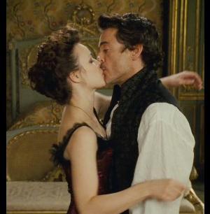 Irene Adler kissing Sherlock Holmes